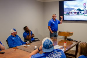 East Texas Roofmasters Team Discussing Renovation Meeting