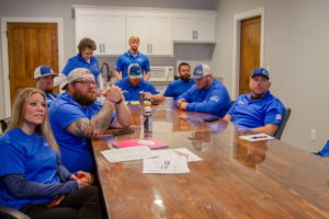 East Texas Roofmasters Team Discussing Renovation